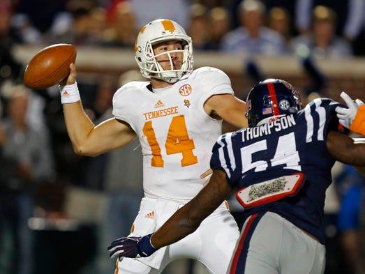 Tennessee quarterback Justin Worley (14) is pressured