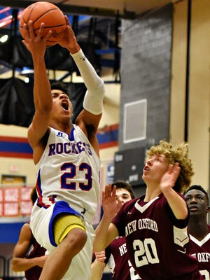 Spring Grove's Eli Brooks, left, takes the ball to the net while New Oxford's Javen Rex defends during the first round of Division 3, Class 5-A boys basketball playoffs at Spring Grove High School, Monday, Feb. 20, 2017. Spring Grove would win the game 73-46. Brooks finished as a finalist for the Mr. Pennsylvania Basketball Award over the weekend, losing out to Reading's Lonnie Walker IV. Dawn J. Sagert photo