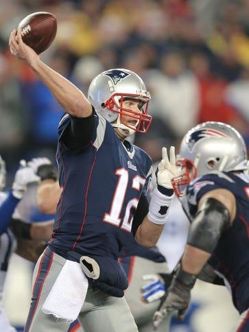 New England Patriots quarterback Tom Brady (12) fires