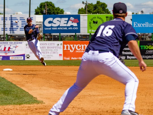 Rumble Ponies second baseman Jeff McNeil throws to first baseman Peter Alonso.