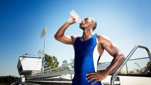 The players died of exercise-associated hyponatremia, which occurs when athletes drink lots of fluids even when they're not thirsty. Too much fluid intake causes cells to swell with water, resulting in muscle cramps, nausea, vomiting, seizures, loss of consciousness and even death.