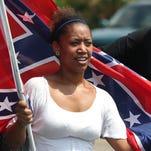 Erika Moreno holds a flag at a pro-Confederate flag rally Sunday in Panama City Beach, Fla.