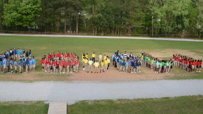 "Pineville Junior High School students wearing Google colors spell out ""Google"" in the middle of the school track Thursday. Rapides Parish schools are going ""Google for education,"" and every student is getting a free Google account."