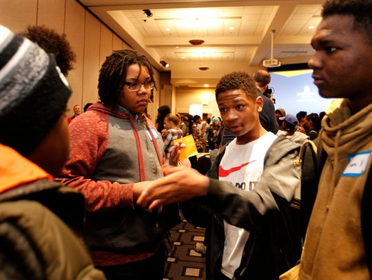 Malachi Moore, 14, (second from right) talks with other