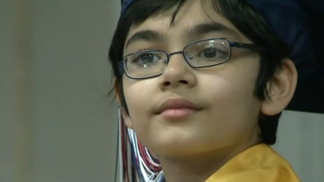 JUNE 8, 2014: 10-year-old Tanishq Abraham at his high school graduation ceremony in Sacramento.