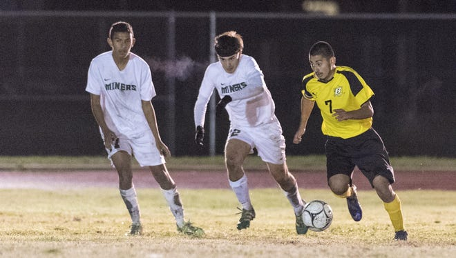Golden West's Enrique Ibarra, right, advances on El Diamante's goal in a West Yosemite League boys soccer game on Thursday, January 12, 2017. Ibarra scored one of Golden West's goals.