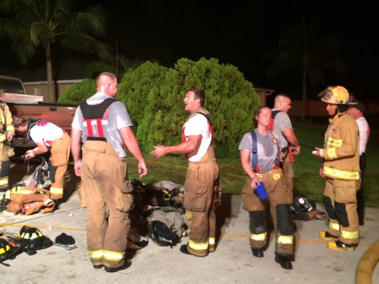 Firefighters talking while fighting an early-morning house fire that killed a family's dog.