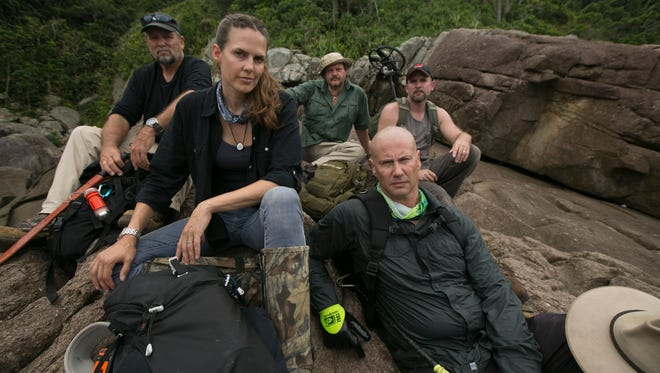 """Treasure hunters Captain Keith Plaskett, left, Mehgan Heaney-Greier, Cork Graham, Dr. Bryan Fry and Jeremy Whalen take a brief rest before resuming their search for lost Incan treasure on the Discovery Channel series """"Treasure Quest."""""""