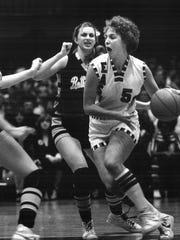 1980: Lorri Bauman drives against Bettendorf's Lisa