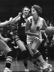 1980: Lorri Bauman drives against Bettendorf's Lisa Irvine (11) and Sue Block. East won 74-55.