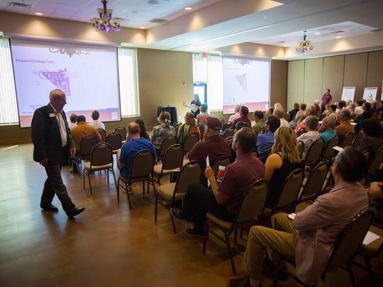 Attendees to a NMSU master plan public forum listen