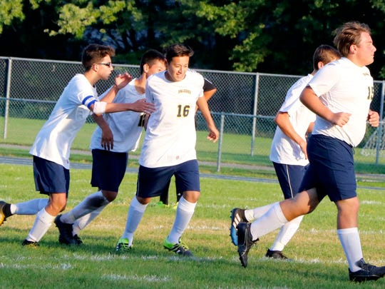 David Guerra, No. 16, is congratulated by his Saddle Brook teammates after an assist against Weehawken.