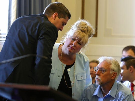 Former University of Cincinnati police officer Raymond Tensing, left, speaks with step mom, Amy Tensing, and his father, Paul, before the start of the second day of Tensing's retrial in Hamilton County Common Pleas Judge Leslie Ghiz's courtroom Friday, June 9, 2017, in Cincinnati.