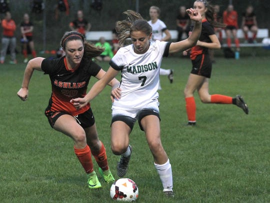 Madison's Kari Eckenwiler and Ashland's Lexi Farrell compete for the ball during a match at Madison last season.