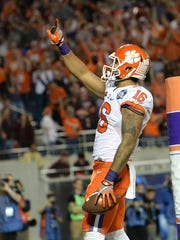 Clemson tight end Jordan Leggett (16) gives points to the stands after catching his 2nd TD of the game during the 2nd quarter of the ACC Championship at Camping World Stadium in Orlando on Saturday, December 3, 2016.