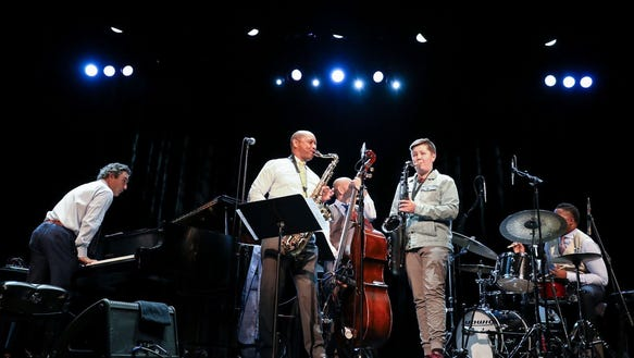 Spencer Morgensen, second from right, joined the Branford Marsalis Quartet — from left, pianist Joey Calderazzo, Marsalis, bassist Eric Revis and drummer Justin Faulkner — for the encore of their Thursday night concert at the Admiral Theatre.