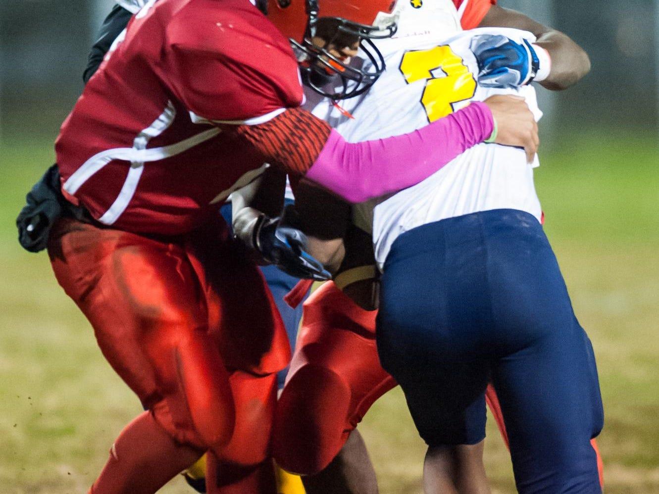Laurel outside linebacker Shyheim Holden (2) hawks down Seaford quarterback Kadeem Hughes (2) for a sack in Laurel last season.