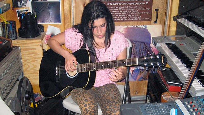 """Amy Winehouse's earliest days and greatest struggles are chronicled in the documentary """"Amy."""""""