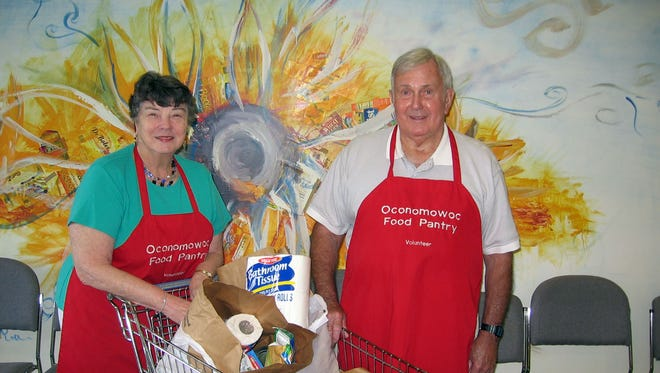 Bill Jackson (right) and his wife Lois were married for 64 years and were longtime volunteers at the Oconomowoc Food Pantry. Bill died Aug. 23.