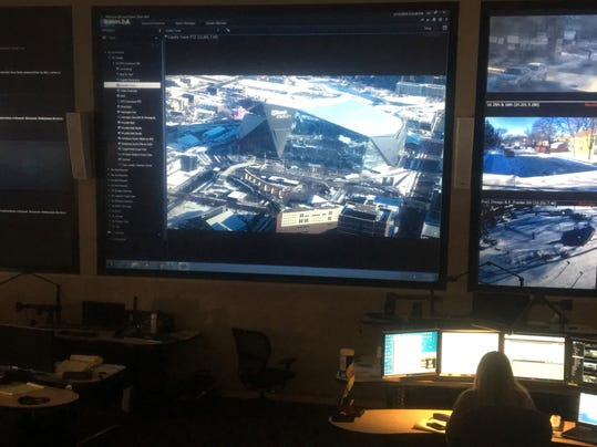 In this Jan. 17, 2018 photo, a woman works at the Emergency Operations Training Facility in Fridley, Minn. where a camera view of U.S.Bank Stadium is shown as security preparations for the Super Bowl Feb. 4 in Minneapolis continues. A huge contingent of local, state and national agencies is working to ensure that the game and dozens of related events are safe. (AP Photo/Jeff Baenen)