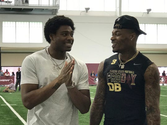 Former Florida State football defensive back Jalen Ramsey, left, who plays for the Jacksonville Jaguars, share some laughs with Derwin James during Florida State Pro Day, Tuesday March 20, 2018, in Tallahassee, Florida. (AP Photo/Joe Reedy)