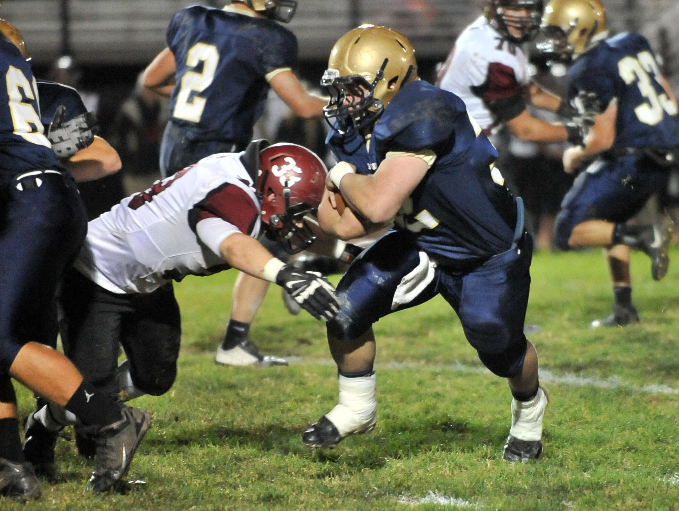 Lancaster's Ryan Fitchpatrick runs the ball during the Golden Gales 38-7 win over Newark Friday night at Fulton Field in Lancaster.