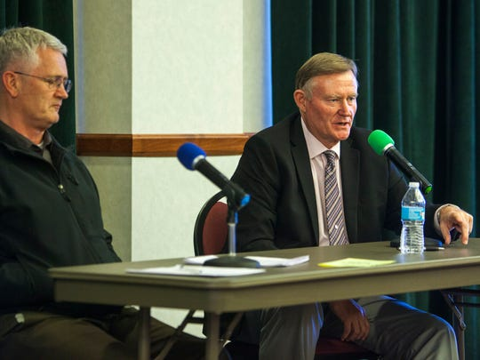 State Sen. Evan Vickers (right) speaks at the Iron
