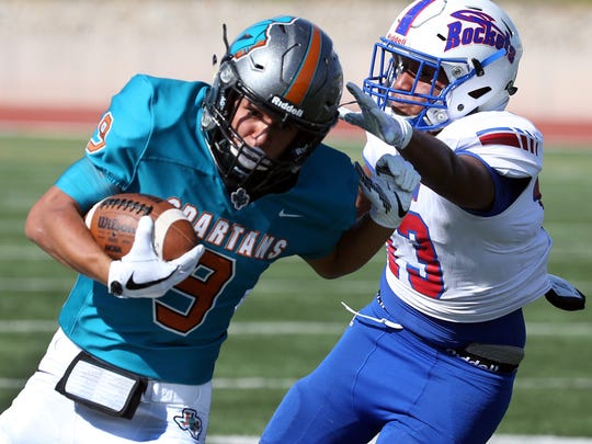 Caleb Gerber, 9, of Pebble Hills gets around Carlos Moreno, 13, of Irvin in a play that set up a touchdown in August 2017 at the Socorro Student Activities Complex.