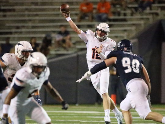 UTEP quarterback Ryan Metz unloads a throw downfield against Rice Saturday night.