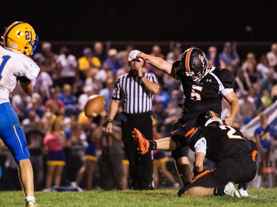 Palmyra's Griffin Weidler kicks the PAT as Palmyra fell to Middletown 17-10 on Friday, Oct. 6, 2017. It was Palmyra's first loss of the season as they fell to 5-1