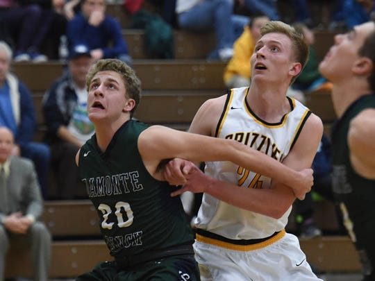 Damonte's Ethan Kulpin and Galena's Mateo Rasmussen look for the rebound in the first half of Tuesday's game at Galena.