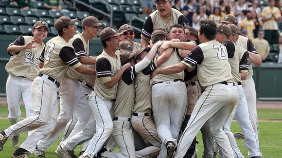 Clarkstown South pitcher Kieran Finnegan is mobbed