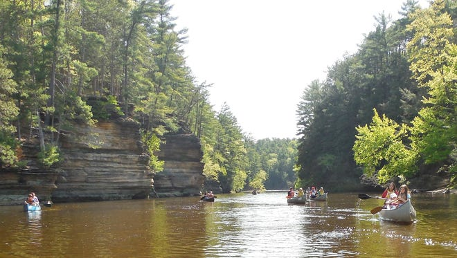 Campers paddle down the placid waters of the Wisconsin River near Upham Woods Youth Learning Center.