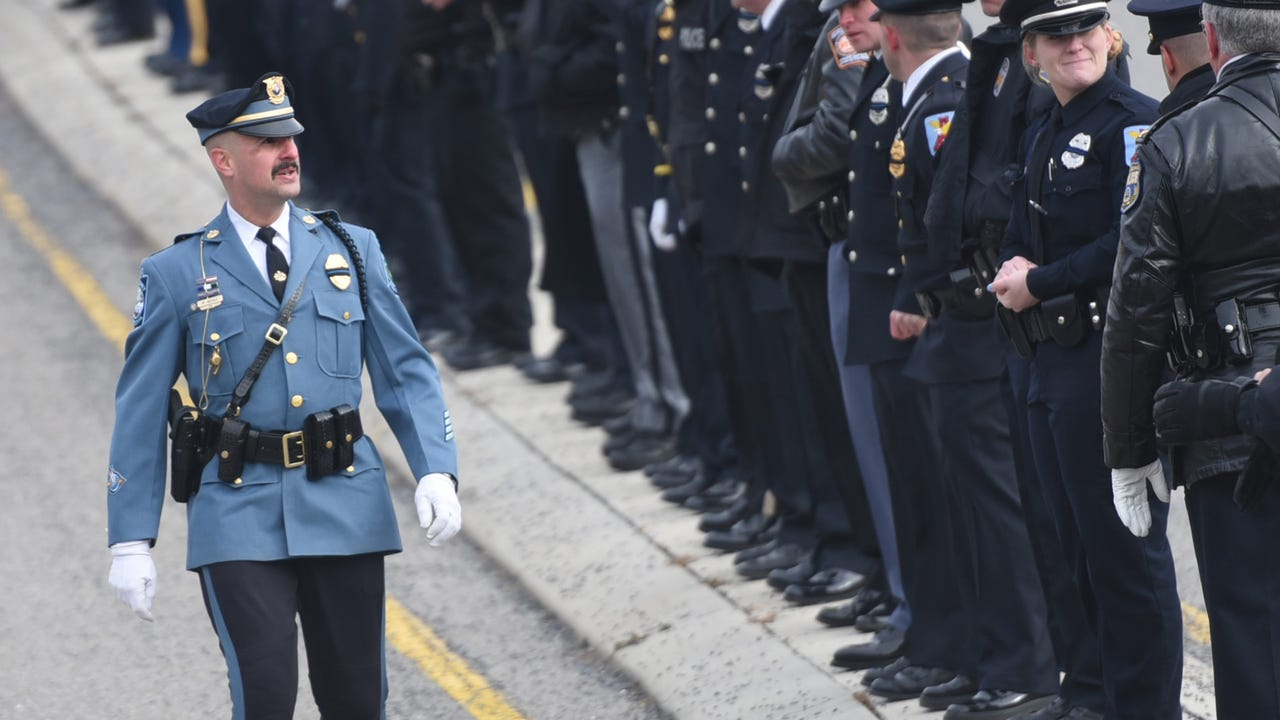 Cpl. Adam Reed talks about Trooper Weaver during the trooper's funeral the morning of Jan. 5.