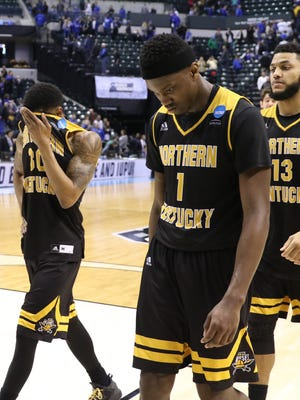 Northern Kentucky Norse Lavone Holland II (30), Jordan Garnett (1) and  Brennan Gillis (13) leave the court after loosing to UK 79-70 in the first round of the NCAA Men's Basketball Championship in Indianapolis on Friday March 17, 2017.