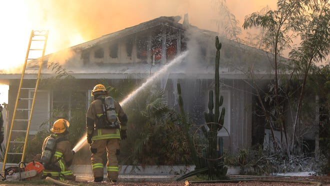 Phoenix fire crews responded to a house fire near Bell Road and 21st Avenue on Dec. 10, 2016.