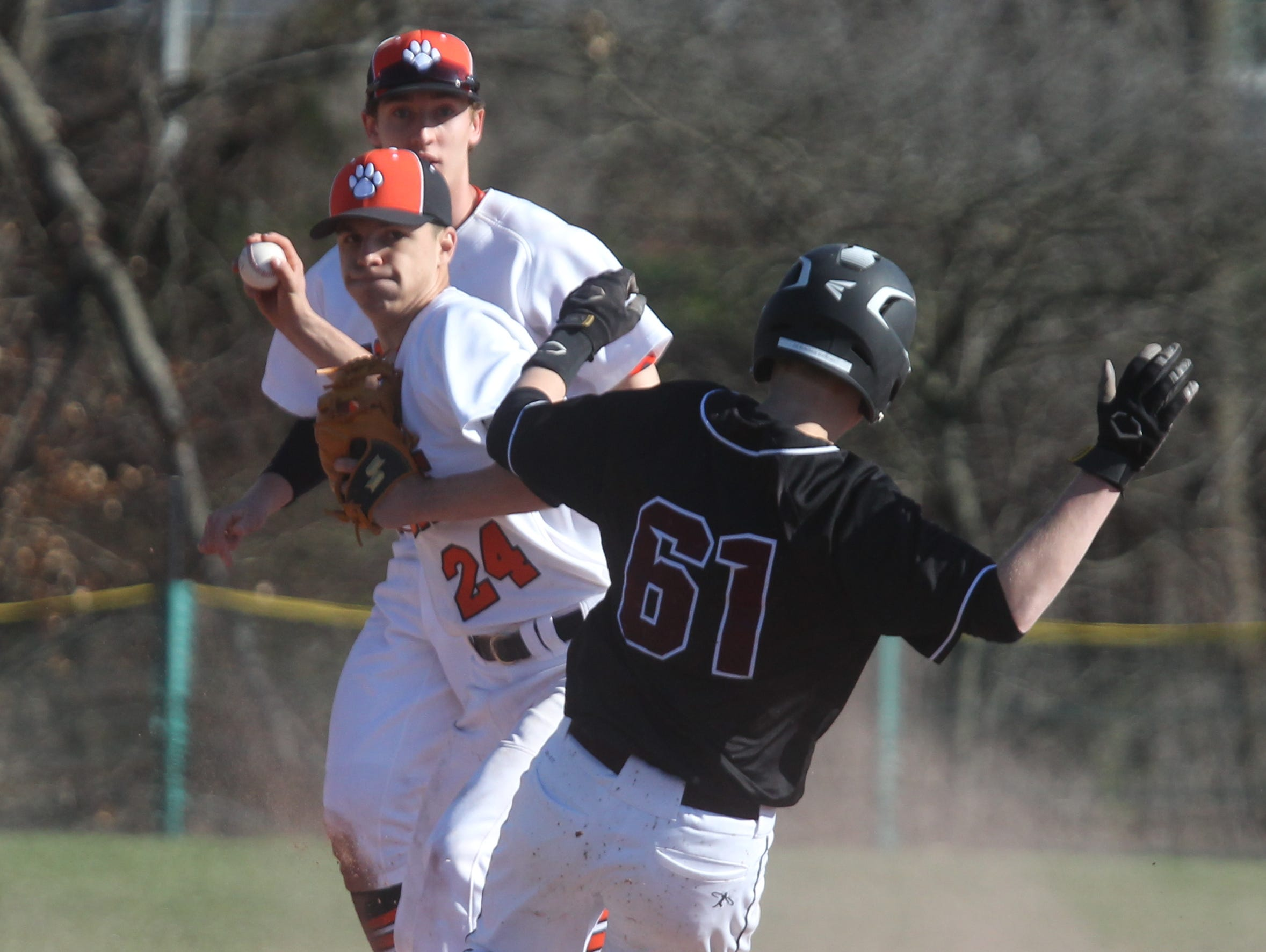 White Plains' Jack Dimarco forces out Scarsdale's Joseph Weintraub, who broke up the double play during a game at White Plains April 12, 2016. White Plains won 7-0.