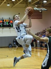 Chatham senior guard Mac Bredahl drives to the basket