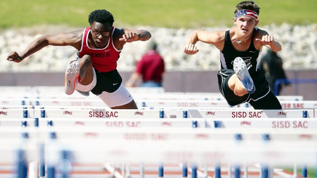 MARK LAMBIE-EL PASO TIMES Franklin's Cody Johnson, right, won the boy's 110 meter hurdles in April at the 6A Area Track and Field Championships. Johnson will run track at the University of Kansas next year.