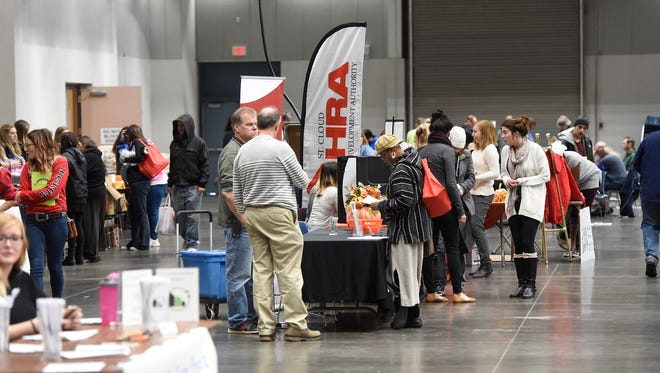 People look at displays from area agencies and organizations during the  Project Connect event Tuesday, Oct. 24 at the River's Edge Convention Center in St. Cloud.
