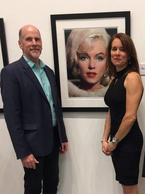 From left, Brian Regan, Gallery Manager of Heather James Fine Art, and Lisa Houston, CEO & President of Find Foodbank.