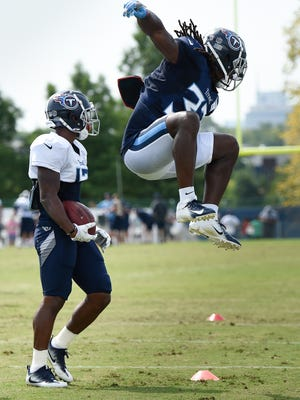 Titans safety Johnathan Cyprien (37) celebrates after wide receiver Cameron Batson (17) was tackled during a drill by cornerback Rico Gafford during practice at Saint Thomas Sports Park Monday, July 30, 2018, in Nashville, Tenn.