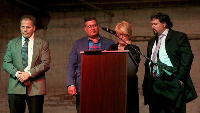 The family of Yvon Robert, a 2017 Professional Wrestling Hall of Fame inductee, speaks on his behalf after he was inducted by Ross Hart (left) during the 16th annual Hall of Fame Induction Banquet Saturday night.