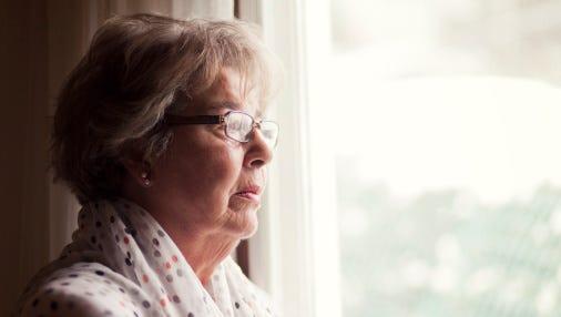 Senior woman looking sad.