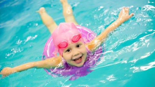 Little girl swimming.