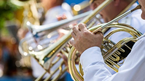 A stock image of a musician playing a horn.