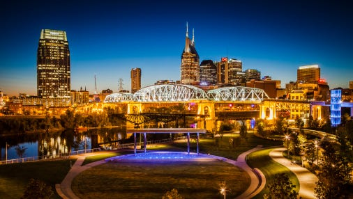 Cumberland Park with Shelby Street Walking Bridge and skyline of Nashville.