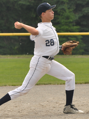 Thurston's Donald Permuy throws out a runner at first