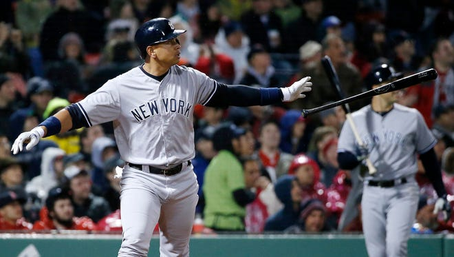 New York Yankees' Alex Rodriguez watches his two-run double during the fifth inning of a baseball game against the Boston Red Sox in Boston, Sunday, May 1, 2016.