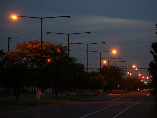 Streetlights are sporadically lit on this stretch of